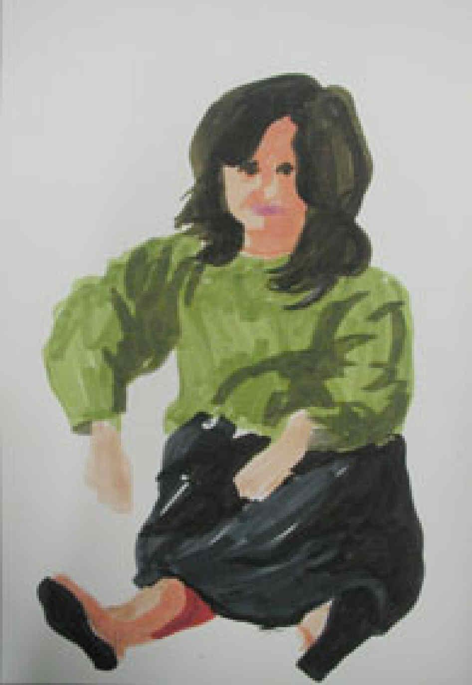 Chica de verde sentada