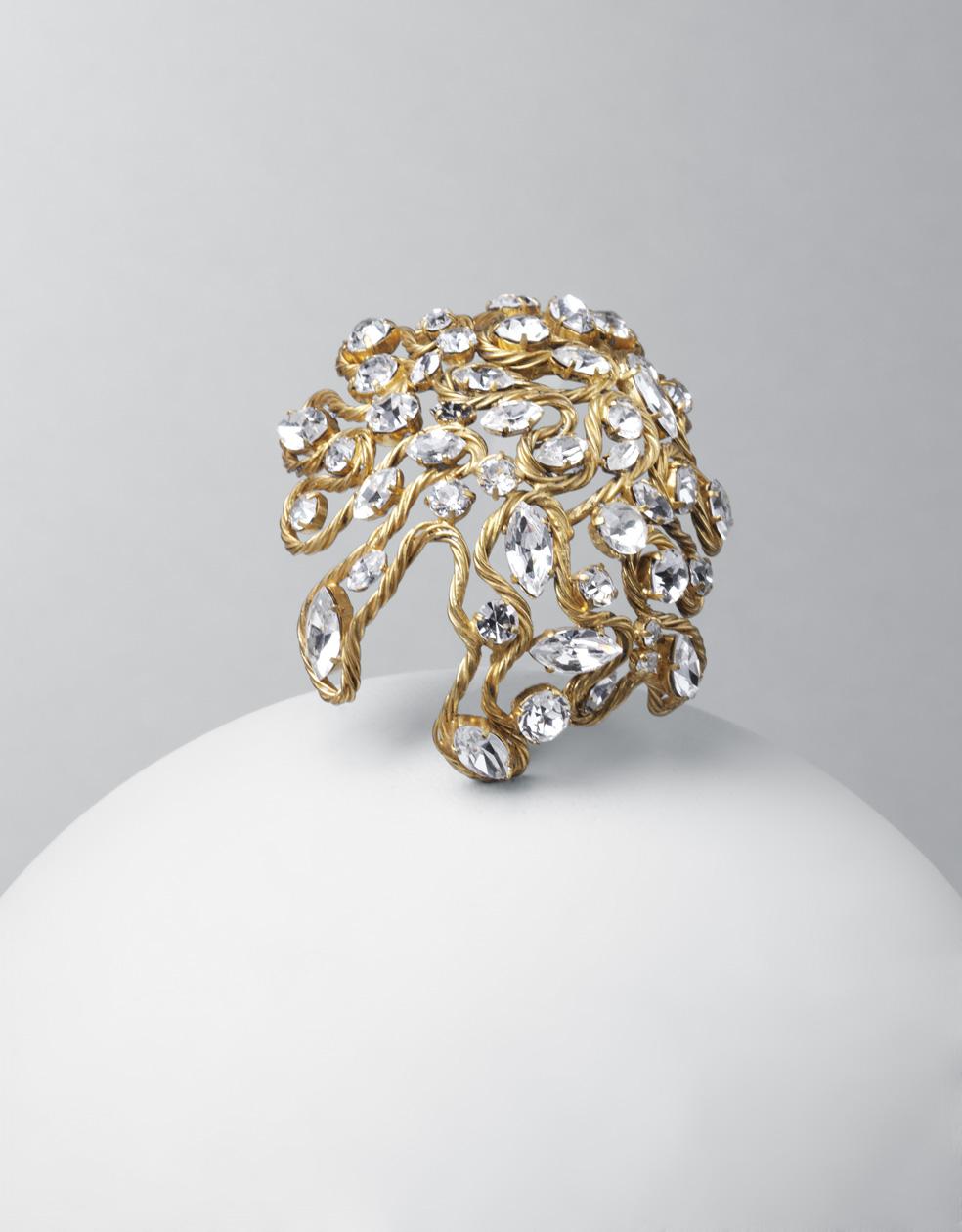 Broche. metal dorado y cristales de Bohemia