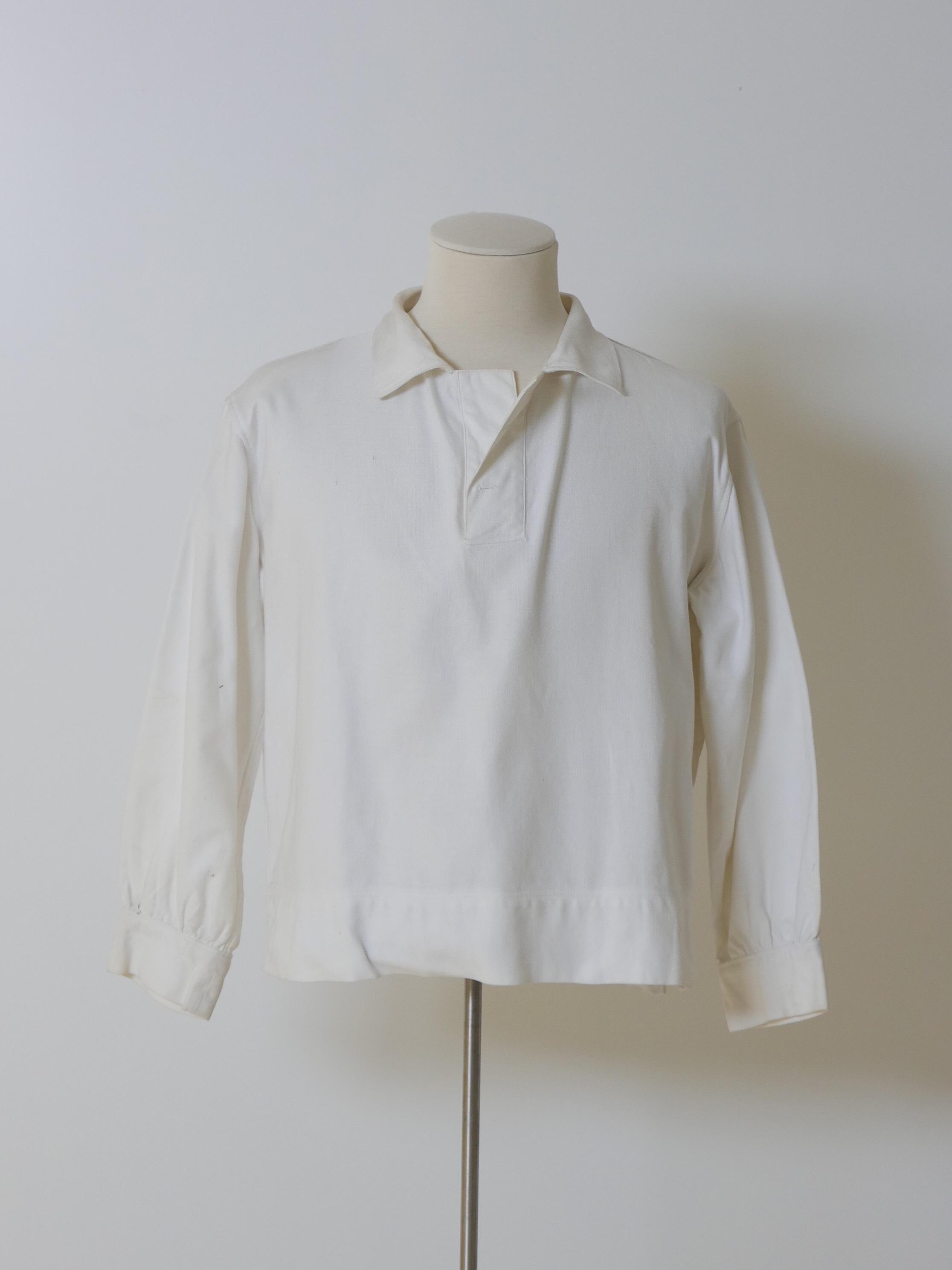 Polo en algodón blanco.