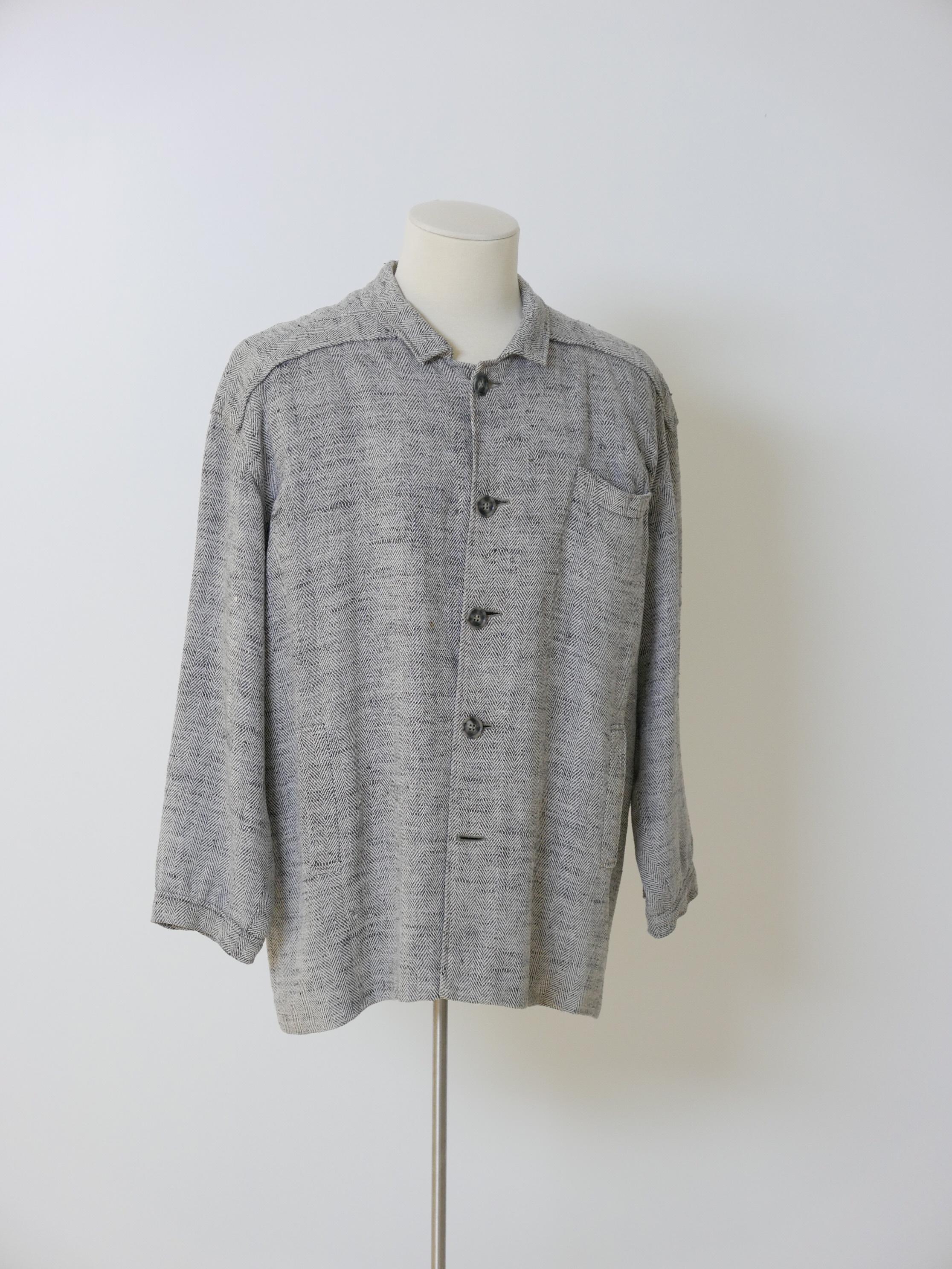 Chaqueta recta en sarga espiguilla en gris jaspeado y blanco.