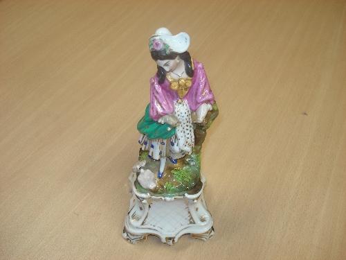 Figura en porcelana de Pasajes