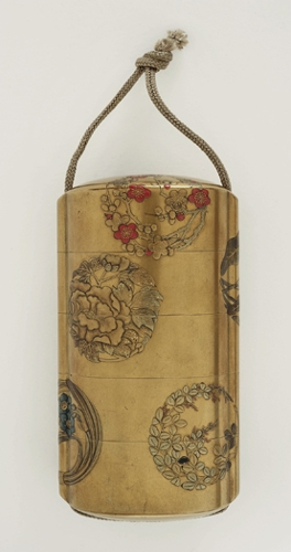Inrō con motivos florales circulares