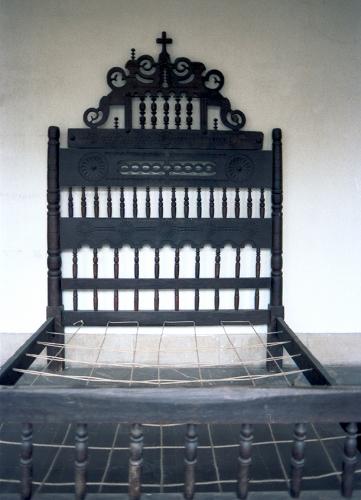 Cama de balaustres